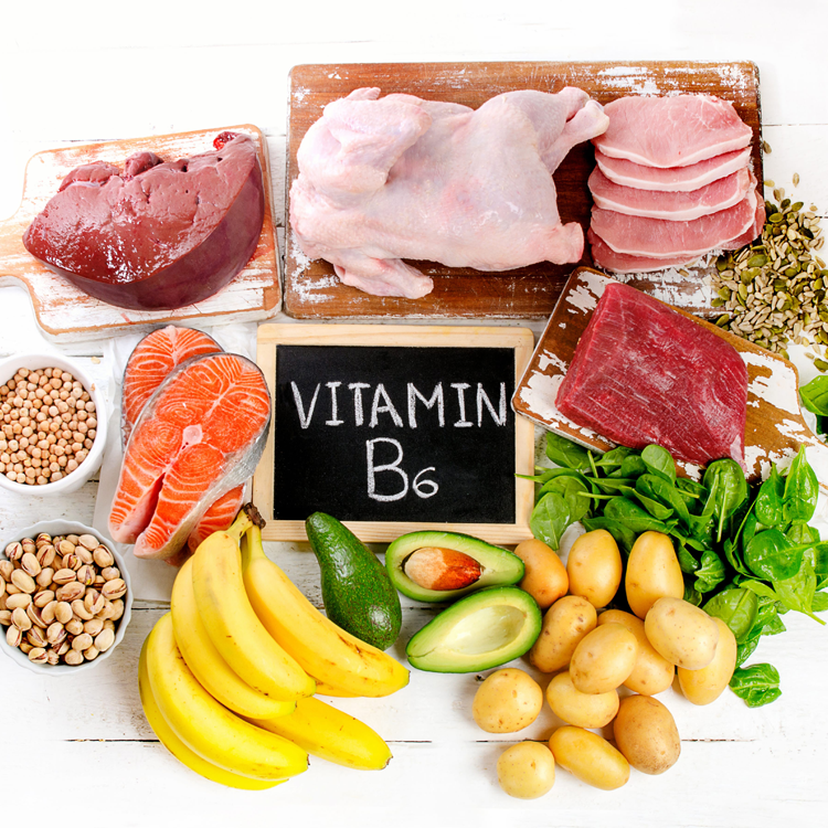 "several meats and vegetables with ""vitamin b6"" written on a small chalkboard"