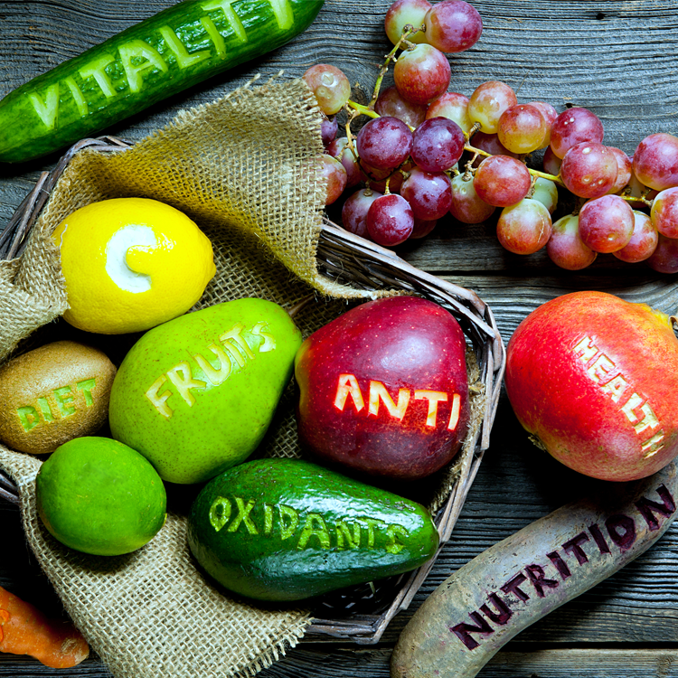 several different fruits and vegitables with words carved into them saying diet fruits anti oxidants