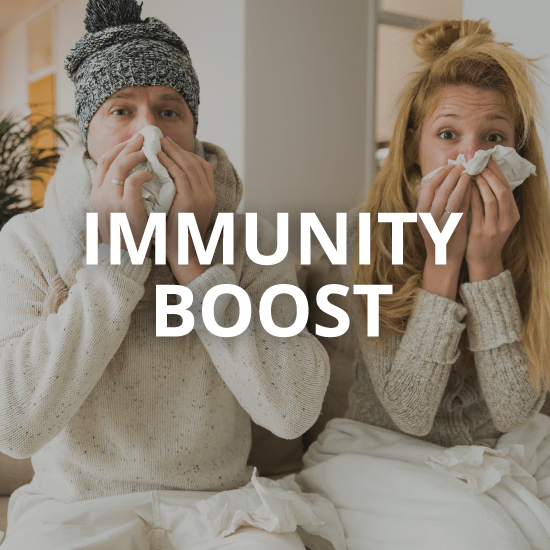 a couple blowing their noses with the words immunity boost overlaid
