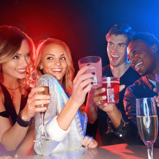 several people drinking in a club